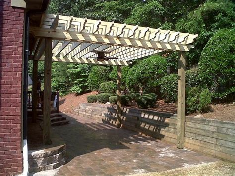 paver patio with a pergola patios steps and