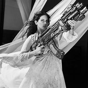 Lana Del Rey takes out a circling chopper with a big gun ...