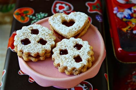 Austrian husarenkrapferl cookies, an almond shortbread dusted with icing sugar & finished off with a dollop of jam, will be the talk of the dessert table! Authentic Linzer Cookies - the famous Christmas Cookie ...