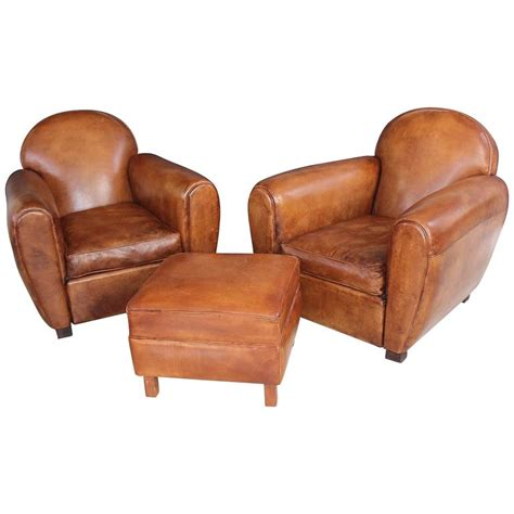 pair of new leather club chairs with ottoman at 1stdibs