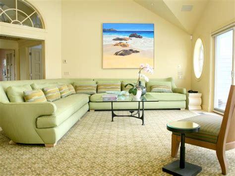 yellow coastal living room  oversized green sofa hgtv