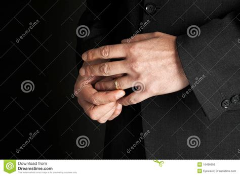 up of man s removing wedding ring stock image 16496692