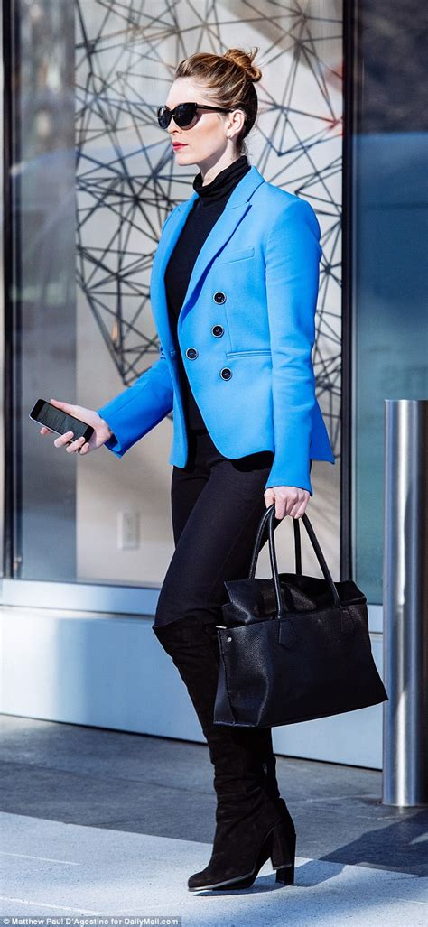 Hope Hicks goes retro in neon blue blazer and black shades ...