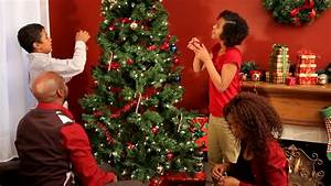 Christmas Tree - A Family Finishes Decorating Their ...