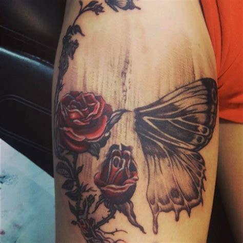 hidden skull  roses  butterfly  johnny atyiannidrakakidis tattoo tattoos tat ink