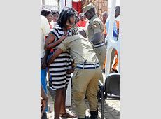 PHOTO Ugandan Male Police Touching Women In Sensitive