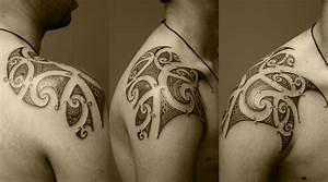 arinenal: tribal tattoos on shoulder and chest