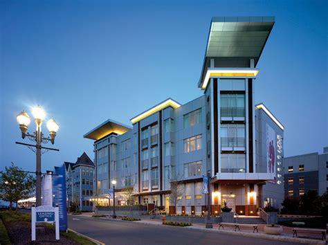modern hotel exterior bungalow hotel beam illuminating architecture