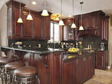kitchens with brown cabinets brown kitchen cabinets with black appliances 8784
