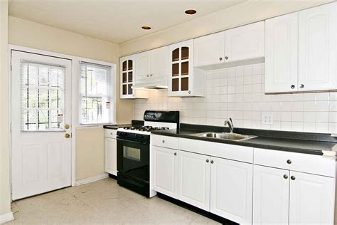 white cabinet kitchen design white kitchen cabinets black granite on kitchen design 1262