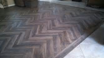 marciano 6 x 36 porcelain tile wood plank design installed as a herringbone pattern
