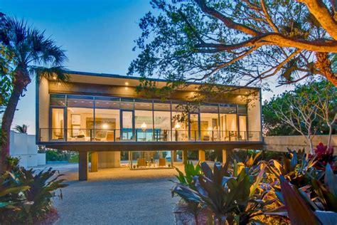 elevated modern glass house  osprey florida