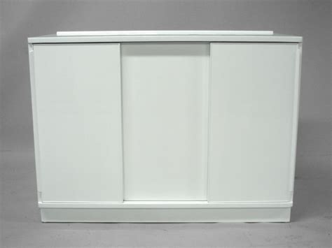 sliding door kitchen cabinet a white lacquered sliding door cabinet by edward wormley 5336