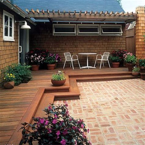 wood deck transition to brick patio for the yard
