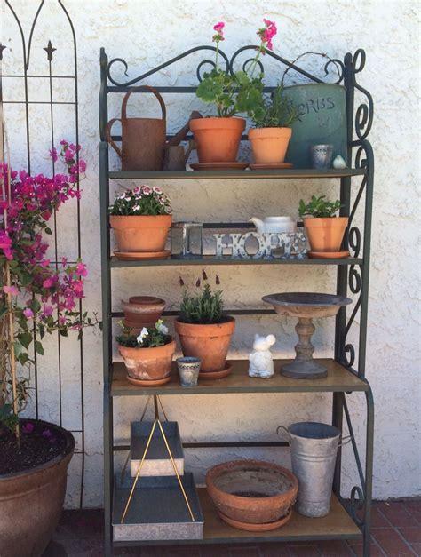 repurposed bakers rack  turned   great garden shelf  simple terra cotta pots