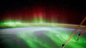 The ISS floating above the Aurora Borealis -- photo by ...