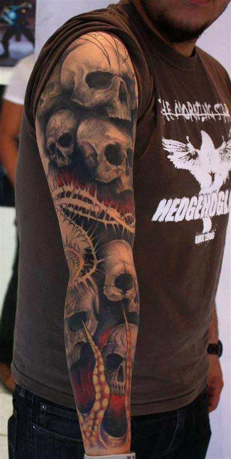 skull sleeve tattoos tattoo arm skulls pile tatto stone roses spikey ink carved sacrifice written into designs tribal interest grey
