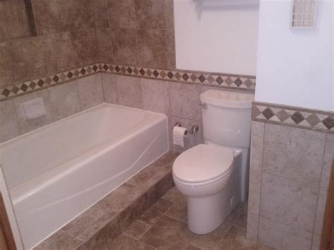 Tile Wainscoting Ideas by Tiled Waincoating Is Of A Bathroom With Tile