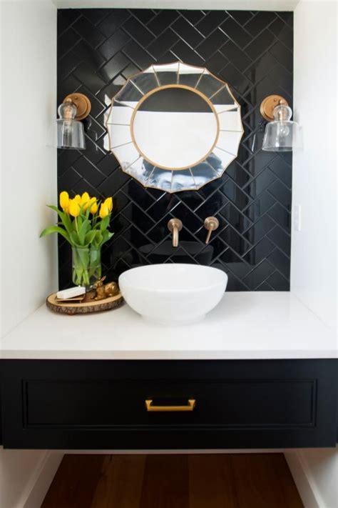 powder room featuring  black tile wall art deco mirror