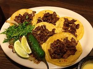 5 Beef fajita mini tacos on corn tortillas served with ...