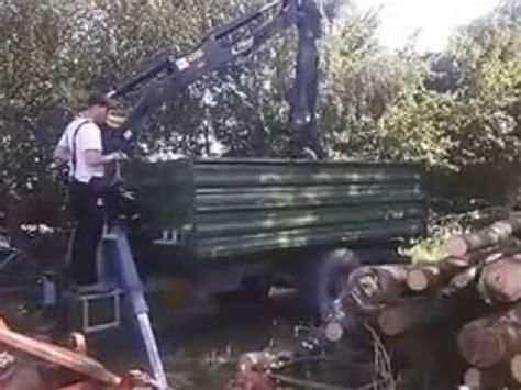 rückewagen mit kran fliegl edk k80 kipper mit kran stammholz abladen ersten