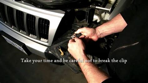 how to change a headlight turn signal on a jeep grand