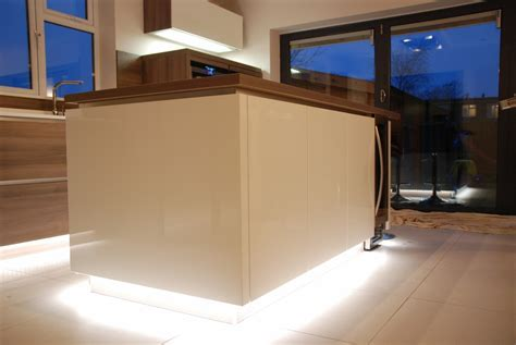 White high gloss kitchen, grey acacia panelling in Brighton