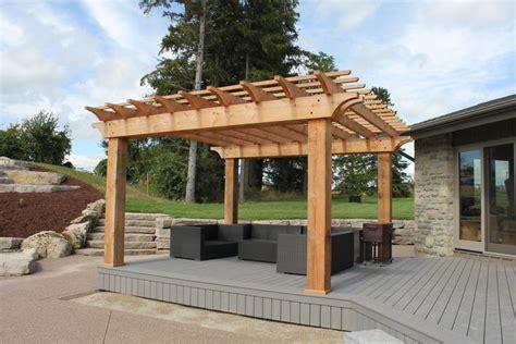 wood pergola accented  grey pvc deck   pvc