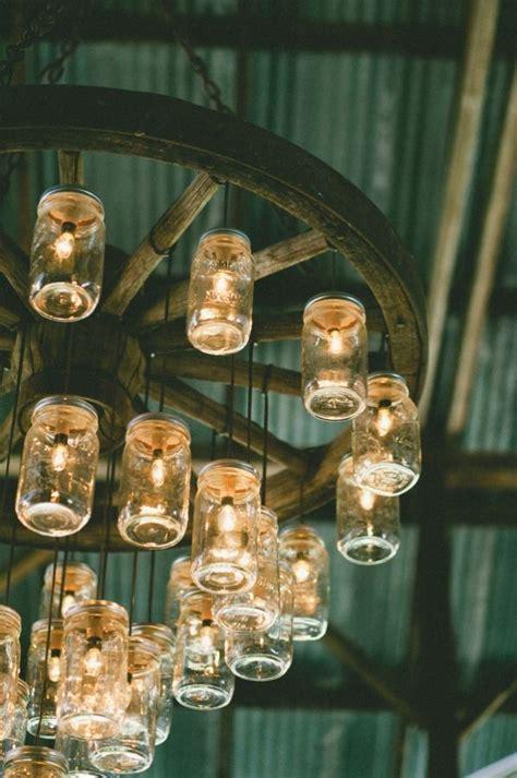 wagon wheel light with mason jars mason jar diy wedding ideas michelle james designs
