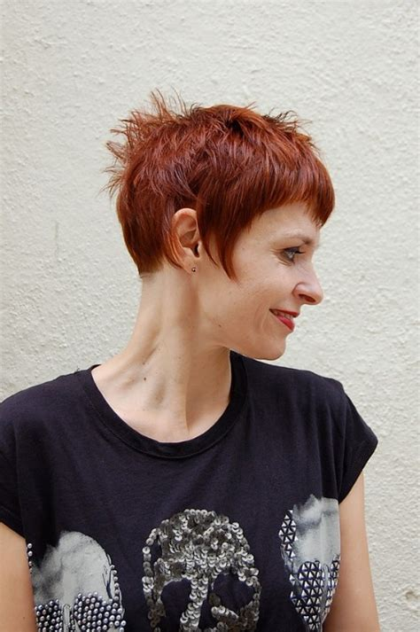 short chic red haircut with short stylish straight bangs