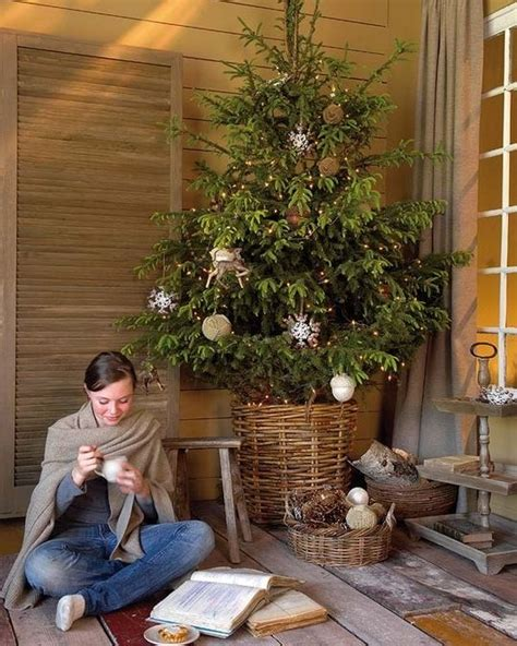 wicker christmas tree skirt and woman sitting next to it