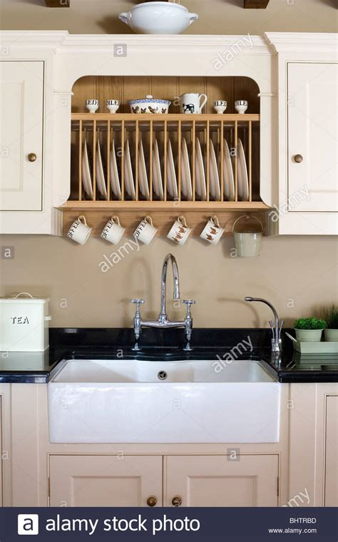 fitted plate rack  fitted cream cupboard  white butlers sink stock photo alamy