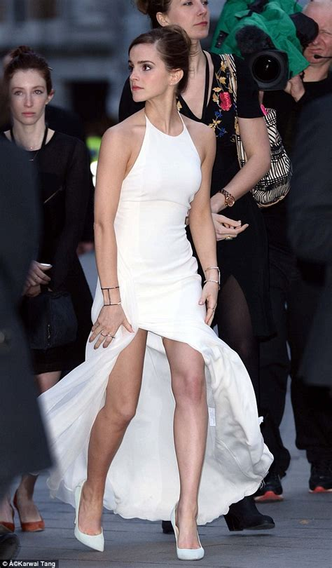 Kimberley Garner wears extremely low cut white dress to
