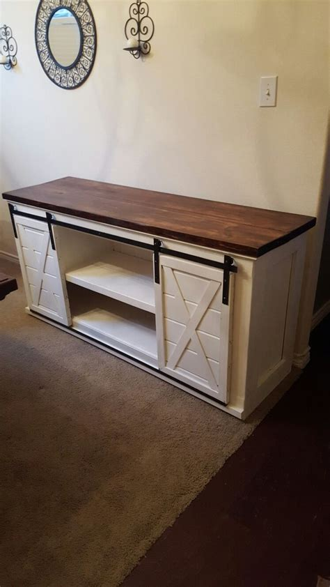 laundry room table with storage entertainment center with sliding barn doors for the