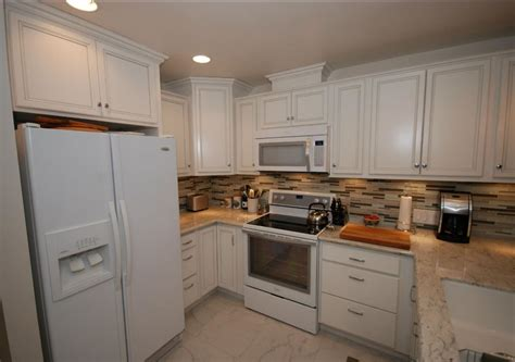 cabinets for small kitchen cardell white with silver glaze cabinets with river white 5079