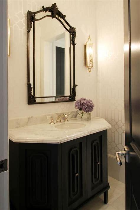 elegant black  white powder room features walls clad