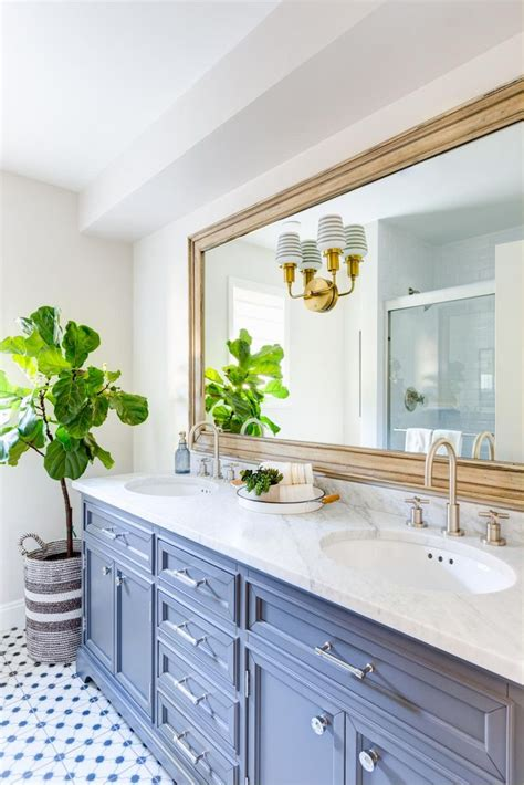 gold bathroom mirror the gold framed mirror and fiddle leaf fig tree give this 12985