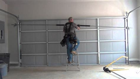 How To Put On Garage Door by 16x7 Garage Door Install