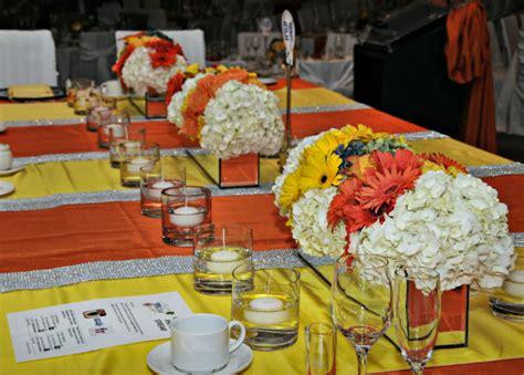 yellow and orange wedding decorations wedding reception decor ideas todaysbride ca