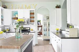 Feature friday ashley39s colorful kitchen southern for Kitchen colors with white cabinets with flower pictures wall art