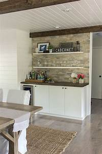 Quartz stacked stone wall provides natural texture and for Kitchen cabinets lowes with cheap wall art for living room