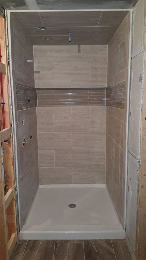 nice size shower   tiles  walls  ceilings