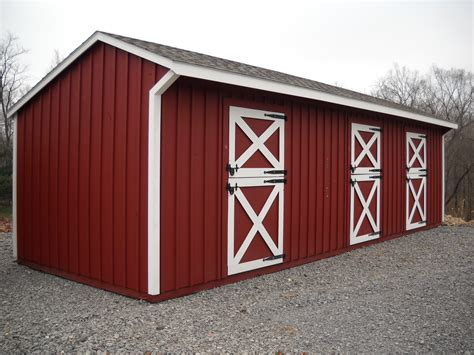 10 x32 shed row barn painted red and white horse barns
