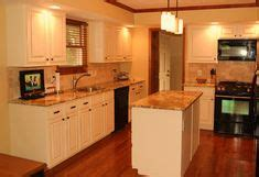 white kitchen cabinets with oak trim white cabinets oak trim for the home 2084