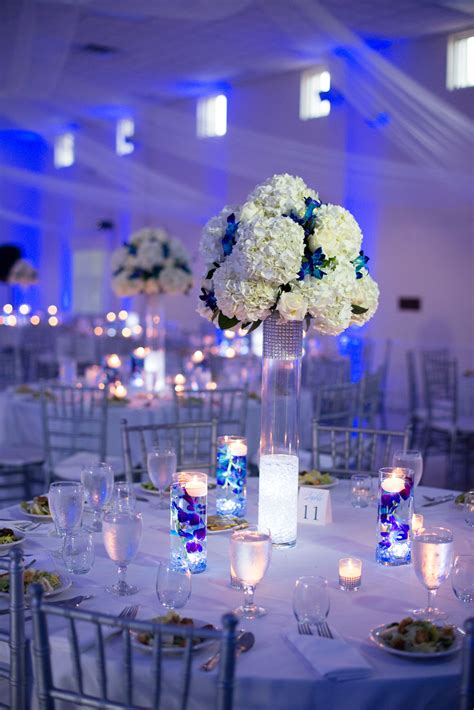white  silver reception decor  blue uplighting