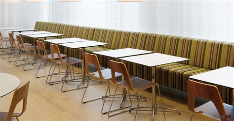 Long Bench Along Wall With X Base Square White Cafe Tables