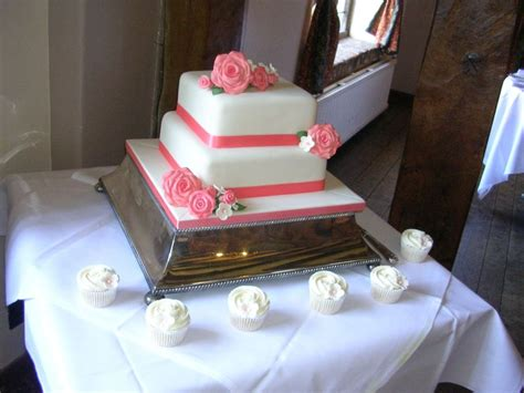 Two Tier Coral And Ivory Wedding Cake