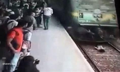 woman hit  train  mumbai survives daily mail