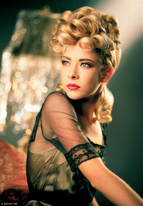 Hairstyles With by Forties Or Fifties Up Style With Large Loops Of Hair