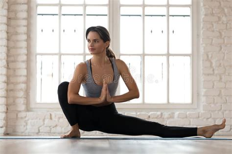Sirsasana is a very safe pose if you learn how to evolve on it. Young Woman Practicing Yoga, Janu Sirsasana Pose Stock Image - Image of position, health: 131138051